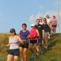 group of women and men hill training