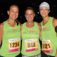 group of ladies smiling wearing USA FIT shirt swag
